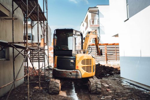 Industrial machinery excavator on construction site, Mini heavy duty excavator moving earth for foundation building